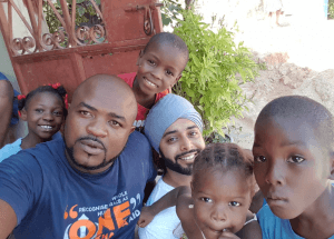 Our local Khalsa Aid man on the ground who is born and bred in Haiti, Marcsan Balan, pictured in the blue and myself in the white T-shirts, at one orphanage we grew to call 'the mountain one'.