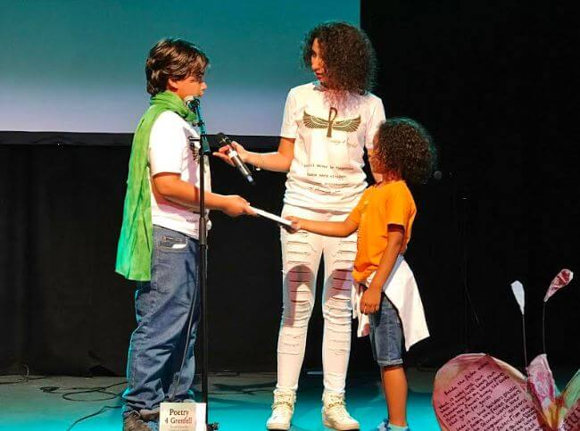 Hesham Rahmaan's Nephew - Receiving the 1st Poetry4Grenfell BOOK offering by Lion'el-Marcel